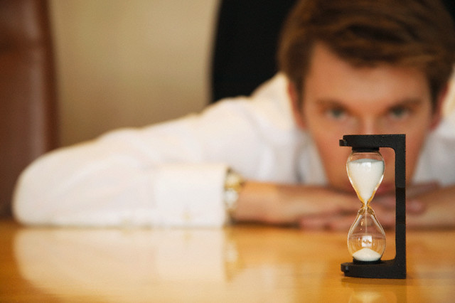 Businessman Watching Timer